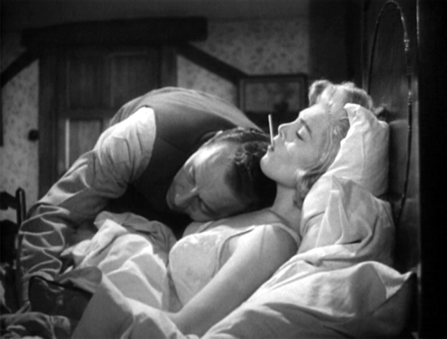 "Dr. Philip Ritter (Paul Henreid) shows Lizabeth Scott's Emily Brent the full extent of his bedside manner during an impromptu house call (uh... hey doc, forget your stethoscope?) in Terence Fisher's ""Stolen Face""."