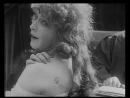 "In a modern day variation of Hester Prynne, selfish, corrupt socialite Edith Hardy (played by Fannie Ward) finds herself branded with the marked symbolizing a rather precipitous plummet from Grace in Cecil B. DeMille's bizarrely immoral 1915 morality play, ""The Cheat""."