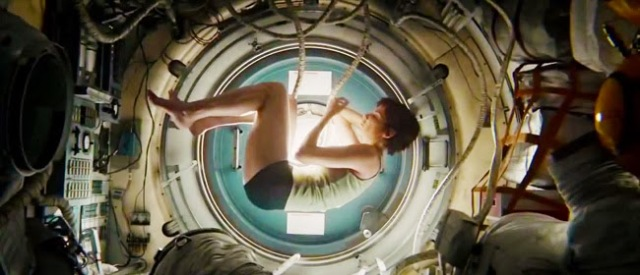 YOU CAN'T GO WOMB AGAIN: Mission specialist Ryan Stone (Sandra Bullock) curls into the classic fetal position- note the conveniently floating umbilical cord -as director Alphonso cuar